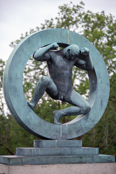 Vigeland installation – the sculptures in Frogner Park, Oslo, Norway. The sculpture area in Frogner Park covers 80 acres (320,000 m2) and features 212 bronze and granite sculptures, all designed by Gustav Vigeland. Most of the statues depict people engaging in various typically human pursuits, such as running, wrestling, dancing, hugging, holding hands and so on. However, Vigeland occasionally included some statues that are more abstract, including one statue, which shows an adult male, fighting off a horde of babies.