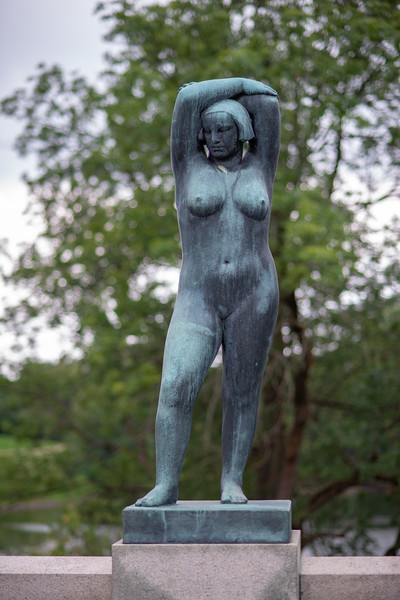 Naked lady, Vigeland installation – the sculptures in Frogner Park, Oslo, Norway. The sculpture area in Frogner Park covers 80 acres (320,000 m2) and features 212 bronze and granite sculptures, all designed by Gustav Vigeland. Most of the statues depict people engaging in various typically human pursuits, such as running, wrestling, dancing, hugging, holding hands and so on. However, Vigeland occasionally included some statues that are more abstract, including one statue, which shows an adult male, fighting off a horde of babies.