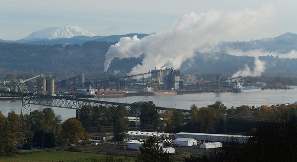 Factories along the Columbia River.  Mt. St. Helens, Washington, in the distance on the upper left of image.