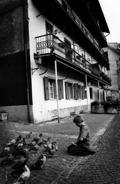 Boy feeding pigeons.<br /> Ljubljana, Slovenia, 2001.