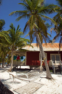 Cottage and hammock on the beach.