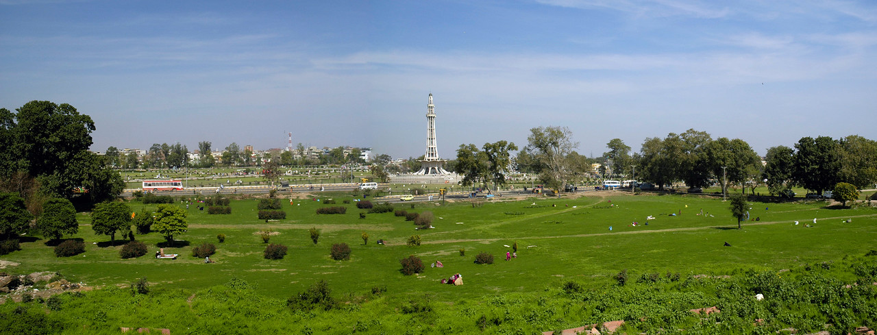 """Panoramic image of Minar-e-Pakistan.<br /> Minar-e-Pakistan is a tall minaret in Iqbal Park Lahore, Pakistan. Built in commemoration of the Lahore Resolution. The minaret reflects a blend of Mughal and modern architecture, and is constructed on the site where on March 23, 1940, seven years before the formation of Pakistan, the Muslim League passed the Lahore Resolution (Qarardad-e-Lahore), demanding the creation of """"Pakistan"""". This was the first official declaration to establish a separate homeland for the Muslims living in the subcontinent. Pakistan now celebrates this day as a national holiday each year. The monument attracts visitors from all over Pakistan, as well as the inhabitants of the Walled City of Lahore. The large public space around the monument is commonly used for political and public meetings. The tower was designed by Naseer-ud-Deen Murat Khan a Pakistani architect of (Daghestan) Russian descent,and structural engineer was Abdur Rahman Khan Niazi. The base is about 8 meters above the ground. The tower rises about 60 meters on the base, thus the total height of minaret is about 702 meters above the ground."""