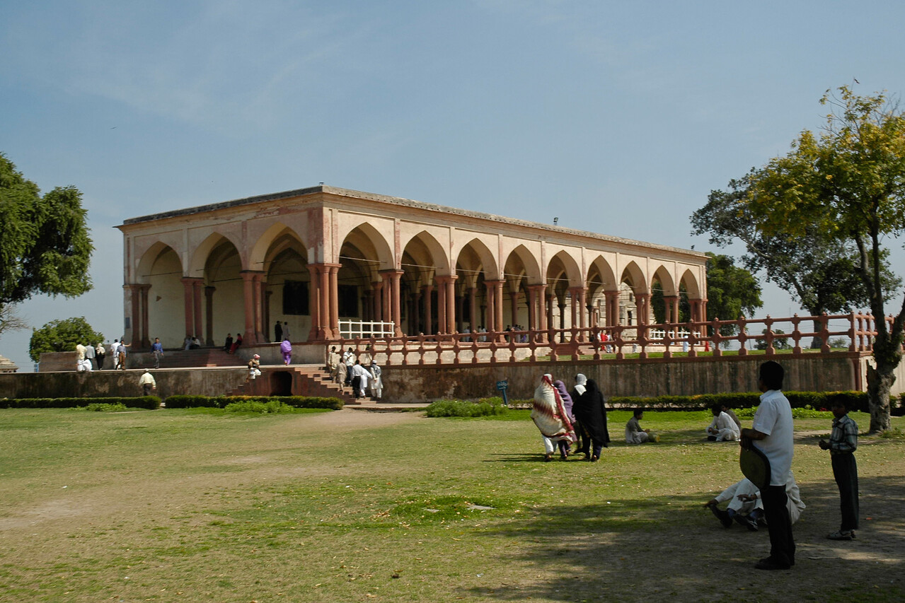 Diwan-e-Khas: Hall of Special Audience. The Lahore Fort, locally referred to as Shahi Qila (Urdu: شاهی قلعہ ) is the citadel of the city of Lahore, Punjab, Pakistan. It is located in the northwestern corner of the Walled City of Lahore in Pakistan. The trapezoidal composition is spread over 20 hectares. Origins of the fort go as far back as antiquity, however, the existing base structure was built during the reign of Mughal emperor Akbar (1556-1605), and was regularly upgraded by subsequent rulers,having thirteen gates in all. Thus the fort manifests the rich traditions of the entire Mughal architecture.<br /> <br /> The fort is clearly divided into two sections: first the administrative section, which is well connected with main entrances, and comprises larger garden areas and Diwan-e-Aam for royal audiences. The second - a private and concealed residential section - is divided into courts in the northern part, accessible through 'elephant gate'. Some of the famous sites inside the fort include: Sheesh Mahal, Alamgiri Gate, Naulakha pavilion, and Moti Masjid. In 1981, the fort was inscribed as a UNESCO World Heritage Site.