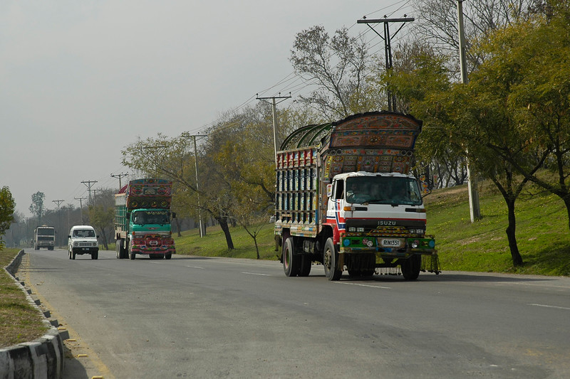 Streets of Islamabad, Pakistan including the colourful trucks.