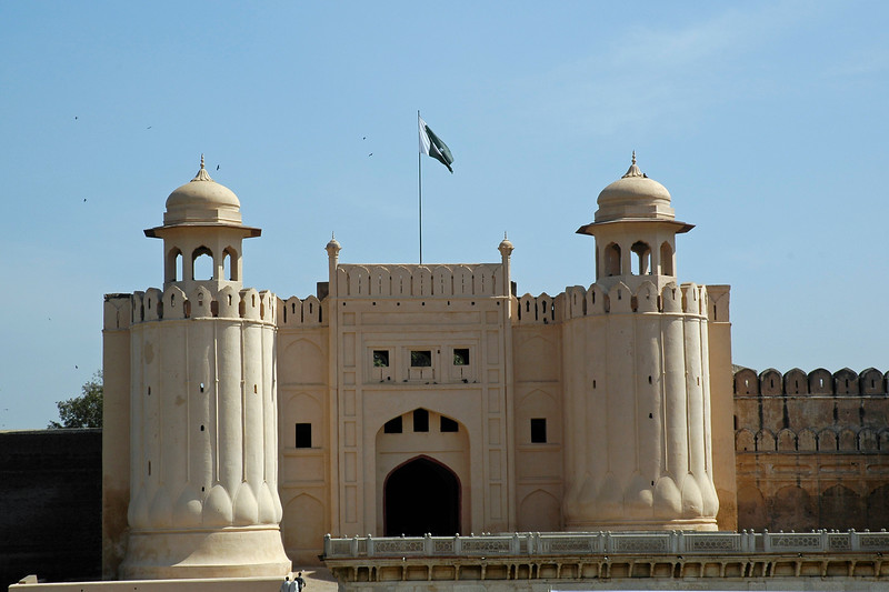 Alamgiri Gate - Main Entrance<br /> The Lahore Fort, locally referred to as Shahi Qila (Urdu: شاهی قلعہ ) is the citadel of the city of Lahore, Punjab, Pakistan. It is located in the northwestern corner of the Walled City of Lahore in Pakistan. The trapezoidal composition is spread over 20 hectares. Origins of the fort go as far back as antiquity, however, the existing base structure was built during the reign of Mughal emperor Akbar (1556-1605), and was regularly upgraded by subsequent rulers,having thirteen gates in all. Thus the fort manifests the rich traditions of the entire Mughal architecture.<br /> <br /> The fort is clearly divided into two sections: first the administrative section, which is well connected with main entrances, and comprises larger garden areas and Diwan-e-Aam for royal audiences. The second - a private and concealed residential section - is divided into courts in the northern part, accessible through 'elephant gate'. Some of the famous sites inside the fort include: Sheesh Mahal, Alamgiri Gate, Naulakha pavilion, and Moti Masjid. In 1981, the fort was inscribed as a UNESCO World Heritage Site.