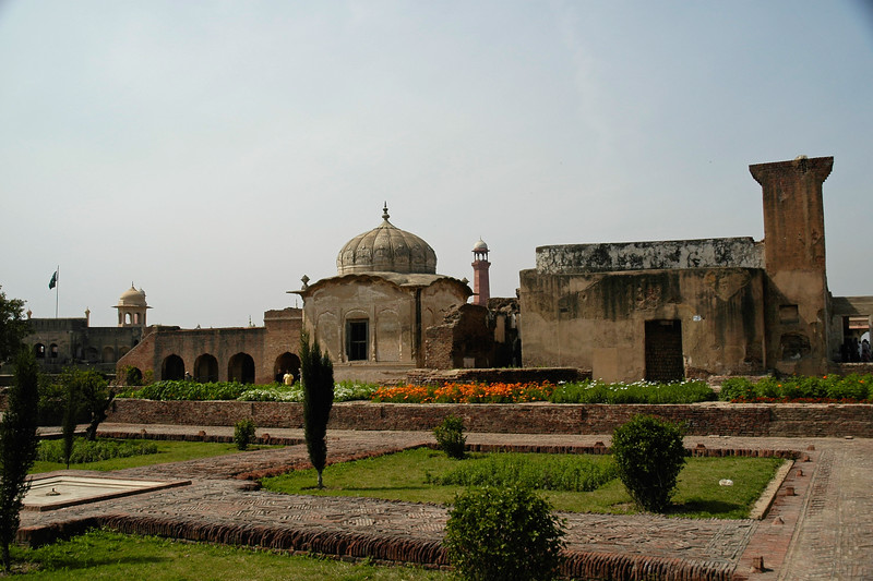 The Lahore Fort, locally referred to as Shahi Qila (Urdu: شاهی قلعہ ) is the citadel of the city of Lahore, Punjab, Pakistan. It is located in the northwestern corner of the Walled City of Lahore in Pakistan. The trapezoidal composition is spread over 20 hectares. Origins of the fort go as far back as antiquity, however, the existing base structure was built during the reign of Mughal emperor Akbar (1556-1605), and was regularly upgraded by subsequent rulers,having thirteen gates in all. Thus the fort manifests the rich traditions of the entire Mughal architecture.<br /> <br /> The fort is clearly divided into two sections: first the administrative section, which is well connected with main entrances, and comprises larger garden areas and Diwan-e-Aam for royal audiences. The second - a private and concealed residential section - is divided into courts in the northern part, accessible through 'elephant gate'. Some of the famous sites inside the fort include: Sheesh Mahal, Alamgiri Gate, Naulakha pavilion, and Moti Masjid. In 1981, the fort was inscribed as a UNESCO World Heritage Site.