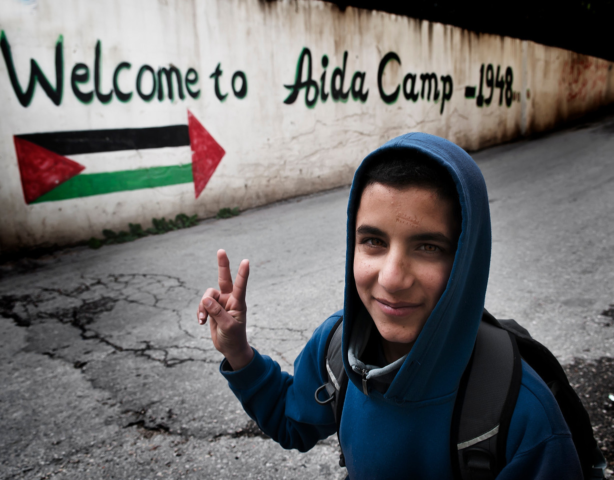 Aida is a Palestinian refugee camp situated 2 kilometers North of Bethlehem and 1 kilometer North of Beit Jala in the central West Bank. Named after a famous coffeehouse (maqhah) located on the site in the early 1940s, Aida camp was established in 1950 and covered an area of 66 dunams. <br /> According to the Palestinian Central Bureau of Statistics, the camp had a population of approximately 3,260 refugees in mid-year 2006.<br /> <br /> Aida refugee camp,Bethlehem , Palestine, 2012.
