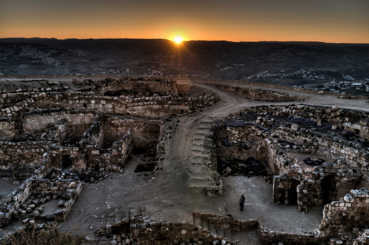 """In 40 BCE, after the Parthian conquest of Syria, Herod fled to Masada. On the way, at the location of Herodion, Herod clashed with the Parthians and emerged victorious. According to the Roman Jewish historian Josephus, he """"built a town on that spot in commemoration of his victory, and enhanced it with wonderful palaces... and he called it Herodion after himself"""" <br /> <br /> Mount Herodium, Palestine, 2012."""
