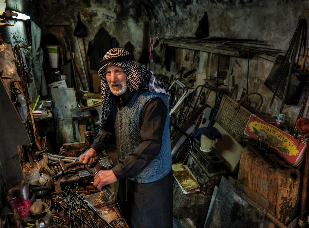 Palestinian metal worker in his workshop.<br /> <br /> Hebron, Palestine, 2012.