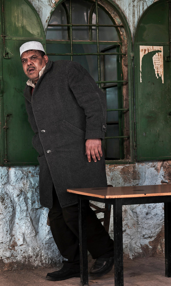 Man outside a coffee shop.<br /> <br /> Hebron, Palestine, 2012.