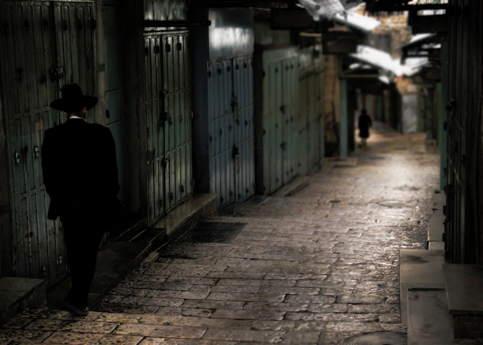Jewish Haredi making there way to the wailing wall through the muslim quarter early in the morning.<br /> <br /> Jerusalem, Israel, 2012.