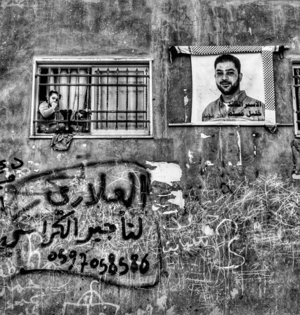 Poster of a suicide bomber (martyr) on the wall of a house in the Aida refugee camp.  Bethlehem, Palestine, 2012.
