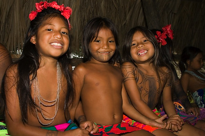 Embera children paint dye on themselves in decorative patterns. Dye is also a repellant from bugs.
