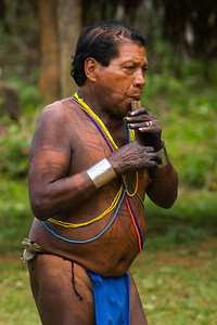 Embera man playing some sort of hand made flute, Chagres National Park, Panama.