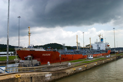 Ship with containers passing through the Pedro Miguel Locks of the Panama Canal in Panama City, Panama.
