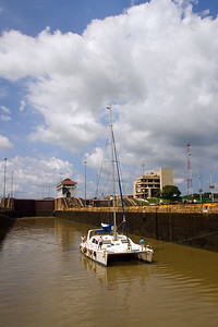 Catamaran passing through the Miraflores Locks of the Panama Canal in Panama City, Panama.