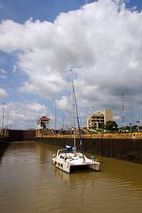 Catamaran passing through the Miraflores Locks of the Panama Canal in Panama City, Panama.