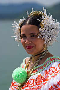 Woman wearing the Pollera, the traditional dress of Panama.  In Panama, hand made polleras evolved during time to a very elaborate piece of clothing. Currently is the National Costume. Panamanian girls and women would generally own two polleras during their life: one before age 16 and one at adulthood. A single pollera can cost from several hundred to several thousands of dollars and take up to a year to create. The mosquetas and tembelques, gold and pearl jewelry, that accompany a pollera are generally passed down as heirlooms through generations.