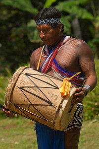 Embera men playing instruments, Chagres National Park, Panama.