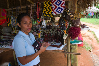 Tour guide explaining craftsmanship of the Embera tribe, Chagres National Park, Panama.