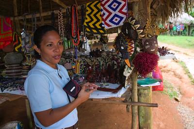 Tour guide explaining craftsmanship of the Embera tribe, Chagres National Park, Panama.