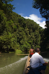 In dug out canoe being guided by indigenous Embera in Chagres National Park, Panama.