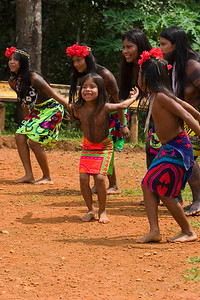Embera women and children perform traditional dance, Chagres National Park, Panama.
