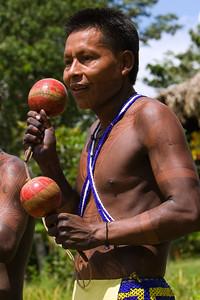 Embera men playing music, Chagres National Park, Panama.