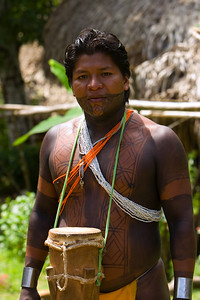 Embera man with drum and painted in dye, Chagres National Park, Panama.