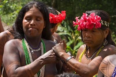 Embera men and women dancing, Chagres National Park, Panama.