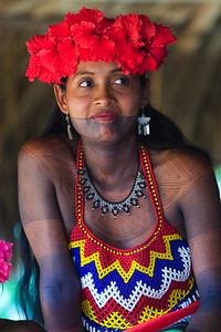 Embera woman wearing a headress of flowers and intriciate hand beaded blouse and necklace, Chagres National Park, Panama.