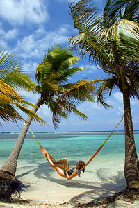 Relaxing in hammock on the beach at South Water Caye.