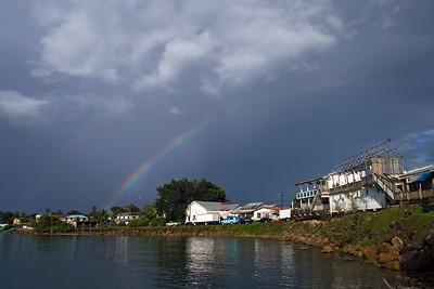 View of coastal town with rainbow, Punta Gorda, Toledo, Belize.