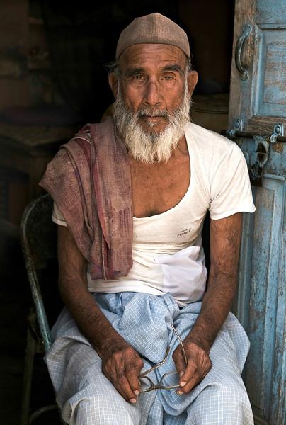 Indian, muslim man.