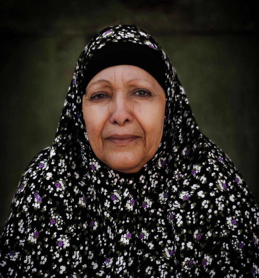 Palestinian, Muslim woman.