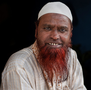 Indian Muslim hostel owner.