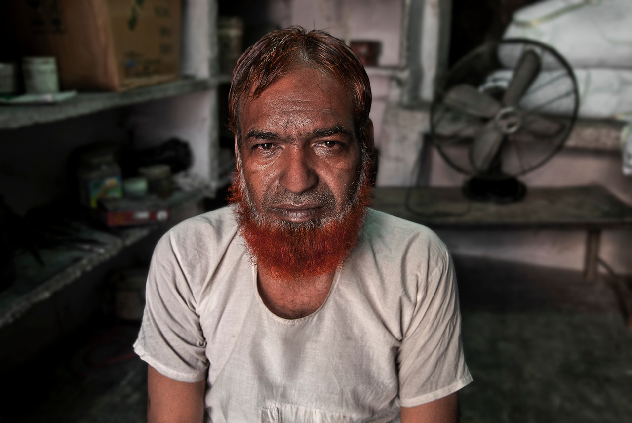 Indian, muslim shop owner.