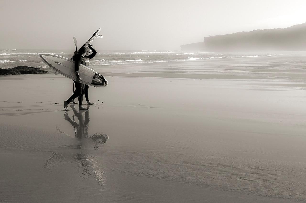 Surfers at the beach in Monte Clerigo, Costa Vicentina, Portugal, 2012.