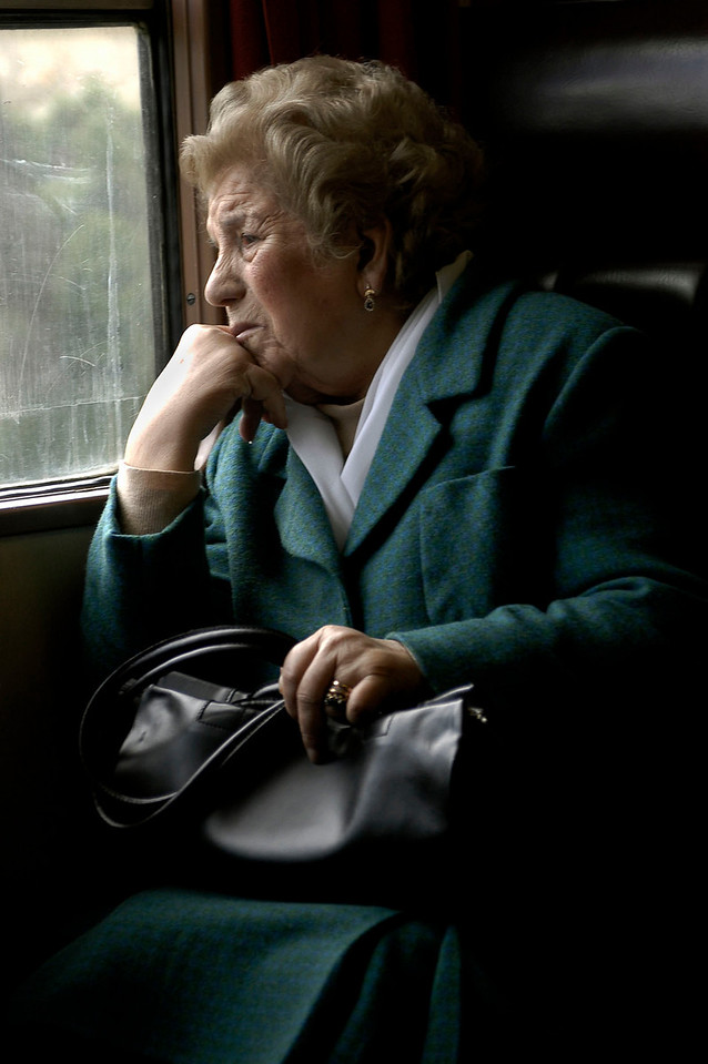 Woman looking out of the train window on her way to Porto, Portugal.
