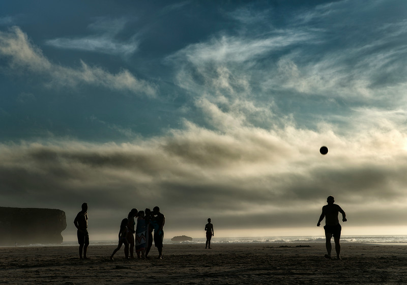 Family playing ball at Amoreira beach.<br /> <br /> Costa Vicentina, Portugal, 2014.
