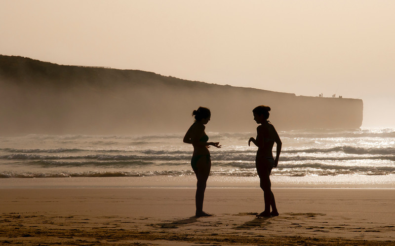 Women chatting on a beach near the village of Aljezur, Costa Vicentina, Portugal.