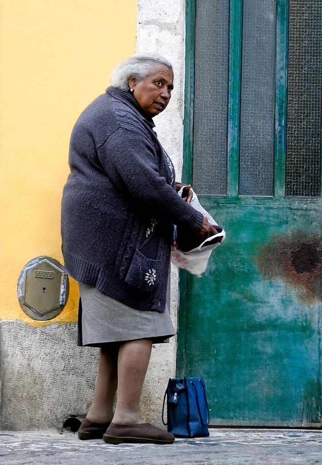 Local woman in the Alfama district, Lisboa, Portugal.