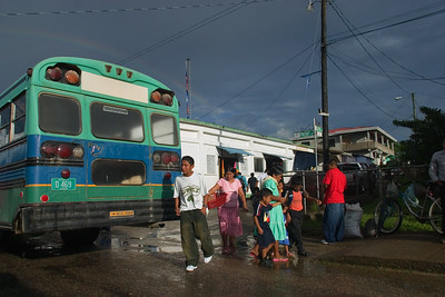 Bus unloading passengers in front of Punta Gorda market, Toledo, Belize.