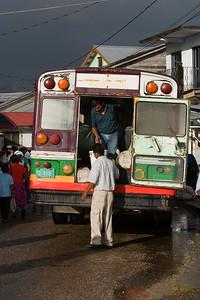 Bus unloading passengers in front of Punta Gorda market, Toledo.