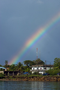 View of coastal town with rainbow, Punta Gorda, Toledo, Belize.