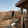 This is the last and longest zip at almost 800 feet....and you leap off the small platform on the upper right. This is Norma taking a photo of Jose. River Riders, Harper's Ferry, West Virginia, digital, 17-40mm lens, Mar 2014.