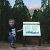 Kyle posing at Garden of the Gods and looking towards Pikes Peak.