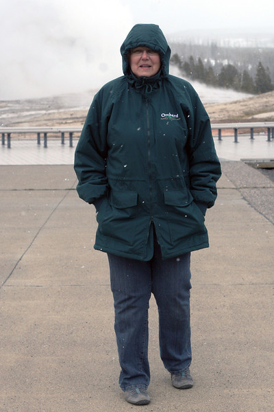 Mom in front of Old Faithful at Yellowstone National Park, April 2013.