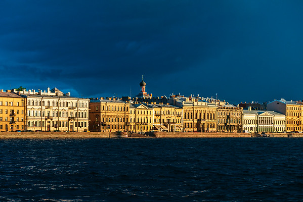 Houses on the Neva bank in the evening sun