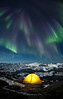 Aurora over tent and icebergs, Greenland